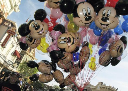 Balloons of Mickey Mouse are carried down main street at Disneyland in Anaheim, California, March 11, 2011. REUTERS/Mike Blake