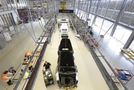 Employees work on the production line for the Rolls Royce Ghost at the Rolls Royce Motor Cars factory at Goodwood near Chichester in souther