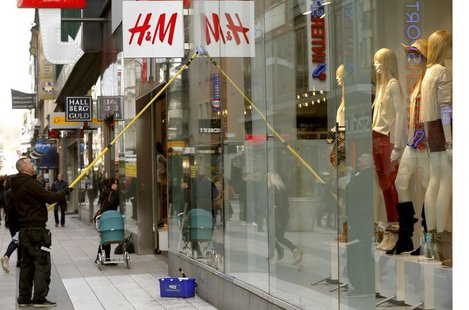 A worker cleans the windows of a branch store of H&M, Hennes & Mauritz, HMb.ST, the world's second-biggest fashion retailer in Sweden's capi