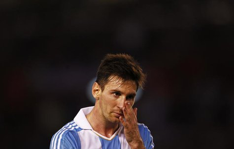Argentina's Leonel Messi pauses on the field as they played Venezuela in a 2014 World Cup qualifying soccer match in Buenos Aires March 22,