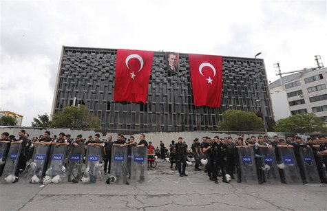 Turkish riot police take position at Taksim Square in Istanbul June 12, 2013. REUTERS/Osman Orsal