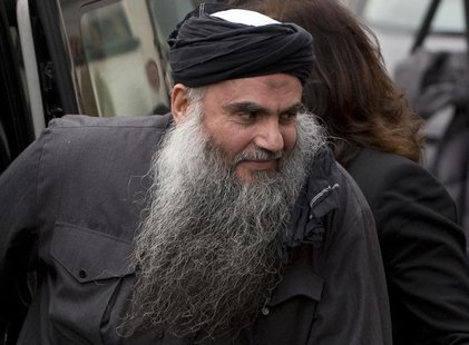 Radical Muslim cleric Abu Qatada is seen arriving back at his home after being released on bail, in London in this November 13, 2012 file ph