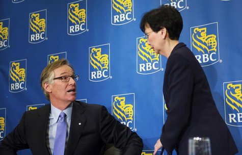 Royal Bank of Canada (RBC) President and CEO Gordon Nixon speaks to Chief Financial Officer Janice Fukakusa (R) after a news conference foll
