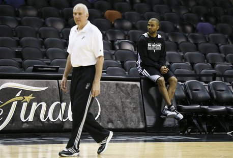 San Antonio Spurs Tony Parker (R) watches other players during practice for their NBA Finals basketball playoff series against the Miami Hea