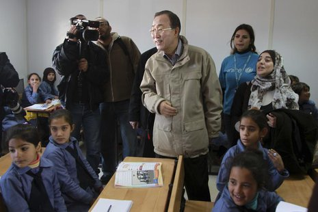 United Nations (U.N.) Secretary-General Ban Ki-moon speaks with children during his visit to a U.N.-run school in Al Zaatri refugee camp, in