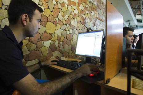 A customer uses a computer at an internet cafe in Tehran May 9, 2011.REUTERS/Raheb Homavandi