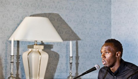 Sprinting champion Usain Bolt of Jamaica speaks during a news conference at the Russian embassy June 11, 2013. REUTERS/Vegard Grott/NTB Scan