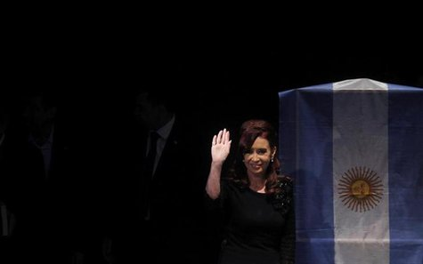 Argentina's President Cristina Fernandez de Kirchner waves as she arrives for the inauguration of a university in Buenos Aires May 16, 2013.