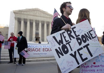 Supporters of gay marriage rally in front of the Supreme Court in Washington March 27, 2013. EUTERS/Joshua Roberts
