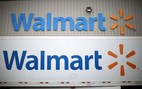 Wal-Mart Stores Inc logos is seen at a company distribution center in Bentonville, Arkansas, in this June 6, 2013 file photo. REUTERS/Rick W