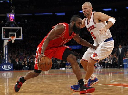 Houston Rockets guard James Harden (L) drives to the basket defended by New York Knicks point guard Jason Kidd in the second quarter of thei