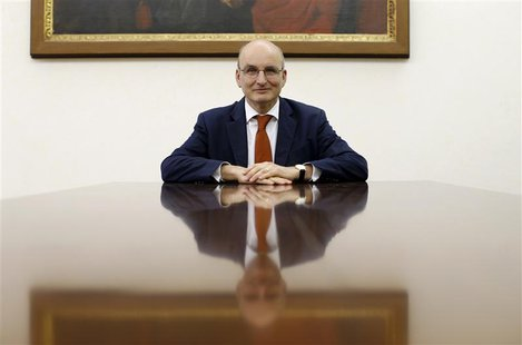 President of the Vatican bank Ernst von Freyberg poses in his office at the Vatican June 10, 2013. Picture take June 10, 2013. To match inte