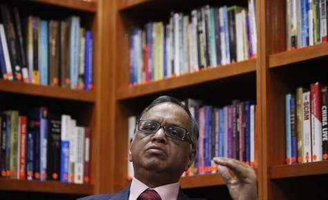 N. R. Narayana Murthy, founder and chairman of Infosys, listens to a question during an interview with Reuters at the company's office in Ba