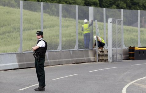 A Police Service of Northern Ireland officer guards the road to the Lough Erne Golf Resort where the G8 summit will be held next week, in Co