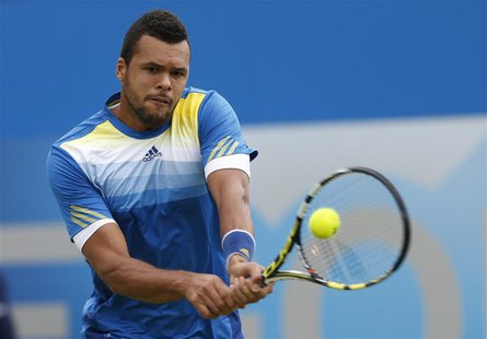 France's Jo-Wilfried Tsonga returns the ball during his men's singles tennis match against his fellow countryman Edouard Roger-Vasselin at t