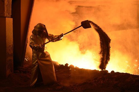 A steel-worker is pictured at a furnace at the plant of German steel company Salzgitter AG in Salzgitter, Lower Saxony on March 21, 2012. RE