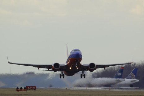 A Southwest Airlines passenger jet lifts off at Reagan National Airport in Washington February 28, 2013. REUTERS/Gary Cameron