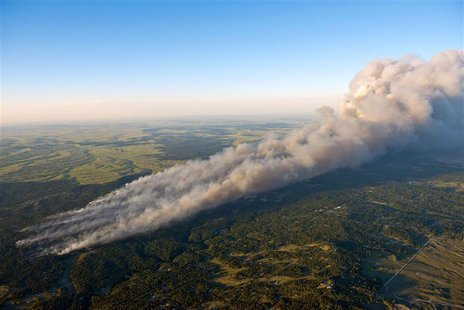 An aerial photo shows wildfire burning homes in Black Forest community near Colorado Springs, Colorado June 11 2013. REUTERS/John Wark