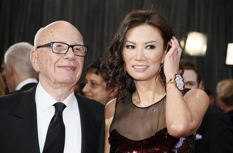 Rupert Murdoch, chairman and CEO of News Corporation, arrives with his wife Wendi Deng at the 85th Academy Awards in Hollywood, California i