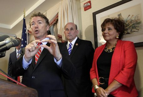 Senator Rand Paul (R-KY) gestures during a news conference to announce legal action against government surveillance and the National Securit