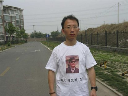 One of China's most prominent dissidents, Hu Jia, wears a shirt in support of blind Chinese lawyer Chen Guangcheng, in this undated file han