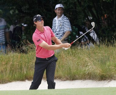Belgium's Nicolas Colsaerts watches his second shot from a bunker on the first hole during the first round of the 2013 U.S. Open golf champi