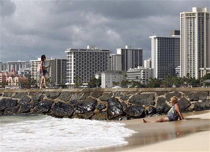 Beachgoers are pictured at Waikiki Beach in Honolulu, Hawaii November 9, 2011. (Credit: Reuters/Chris Wattie)