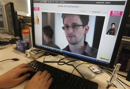 A picture of Edward Snowden, a contractor at the National Security Agency (NSA), is seen on a computer screen displaying a page of a Chinese news website, in Beijing in this June 13, 2013 photo illustration. (Credit: Reuters/Jason Lee)