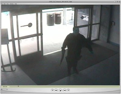 John Zawahri, a suspected gunman, enters the library at Santa Monica City College during the June 7, 2013 shooting incident in this handout