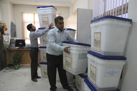Officials prepare ballot boxes for Friday's presidential and city council elections in the northern Iranian city of Amol June 13, 2013. REUT