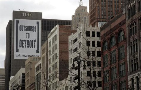 "A larger banner reading ""Outsource to Detroit"" is seen on the side of a building on Woodward Ave in downtown Detroit, Michigan, January 7, 2"