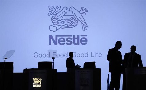 Members of the management of Swiss food maker Nestle arrive for the company's annual general meeting in Lausanne April 11, 2013. REUTERS/Den