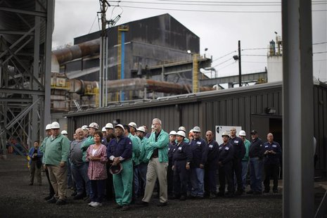 Steelworkers wait to meet U.S. President Barack Obama during a change of shift at V&M Star, in Youngstown, Ohio in this taken May 18, 2010 f