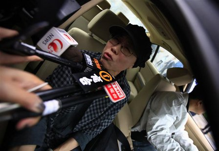 Liu Xia, wife of jailed Nobel Peace Prize Laureate Liu Xiaobo, talks to journalists after a trial outside a court in the Huairou district of