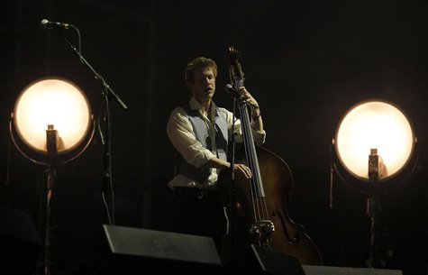 Bass player Ted Dwane performs with his band Mumford and Sons on the main stage during the 2nd day of the Coachella Valley Music & Arts Fest