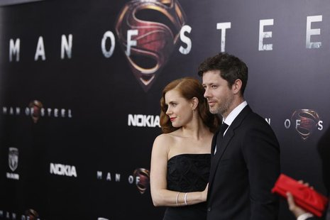 Cast member Amy Adams arrives with actor Darren Le Gallo for the world premiere of the film 'Man of Steel' in New York June 10, 2013. REUTER