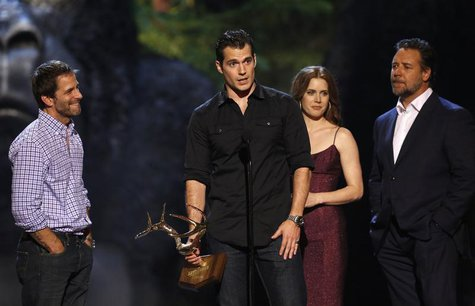 Cast member Henry Cavill speaks, accompanied by director Zack Snyder (L), co-stars Russell Crowe and Amy Adams as they accept the Most Antic