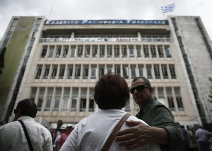 Protesters stand in front of the Greek state television ERT headquarters in Athens June 12, 2013. REUTERS/Yorgos Karahalis