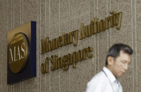 A man leaves the premises of the Monetary Authority of Singapore in the central business district of Singapore January 18, 2013. Picture tak
