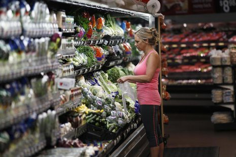 A woman shops at a Walmart Supercenter in Rogers, Arkansas June 6, 2013. The annual shareholders meeting for Walmart takes place June 7, 201