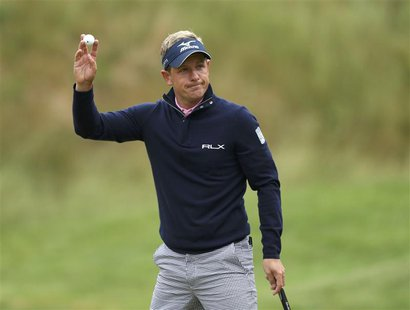 England's Luke Donald reacts to applause on the 17th green during the weather delayed first round of the 2013 U.S. REUTERS/Adam Hunger