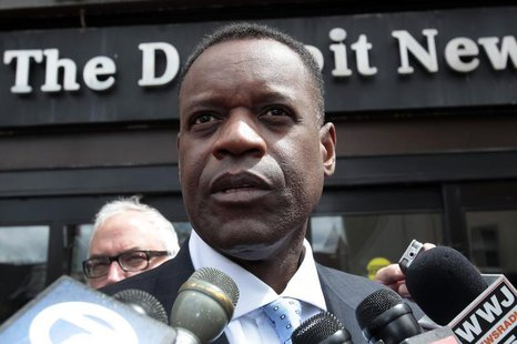 Detroit's emergency financial manager Kevyn Orr talks to members of the media outside the Detroit Newspapers building about the report he de