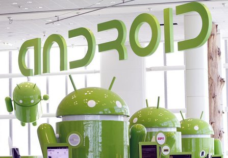Android mascots are lined up in the demonstration area at the Google I/O Developers Conference in the Moscone Center in San Francisco, Calif