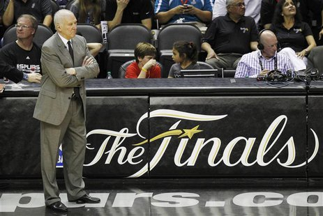 San Antonio Spurs head coach Gregg Popovich watches his team play the Miami Heat during the fourth quarter in Game 4 of their NBA Finals bas