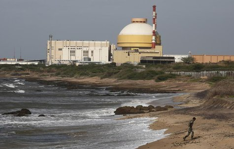 A policeman walks on a beach near Kudankulam nuclear power project in the southern Indian state of Tamil Nadu September 13, 2012. REUTERS/Ad