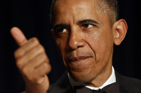 U.S. President Barack Obama gestures at the White House Correspondents Association Dinner in Washington April 27, 2013. REUTERS/Kevin Lamarq