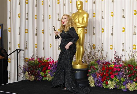 "Adele Adkins of Britain leaves the stage with her Oscar for Best Original Song for ""Skyfall"" at the 85th Academy Awards in Hollywood, Califo"