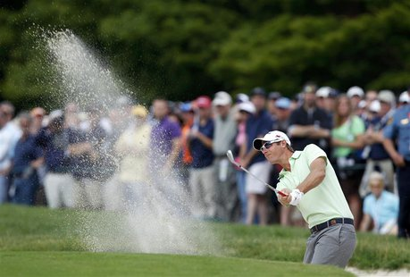 Belgium's Nicolas Colsaerts hits from a sand trap to the first green during the second round of the 2013 U.S. Open golf championship at the