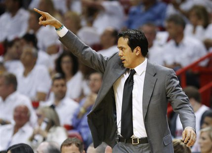 Miami Heat head coach Erik Spoelstra directs his team against the San Antonio Spurs during the first quarter in Game 2 of their NBA Finals b