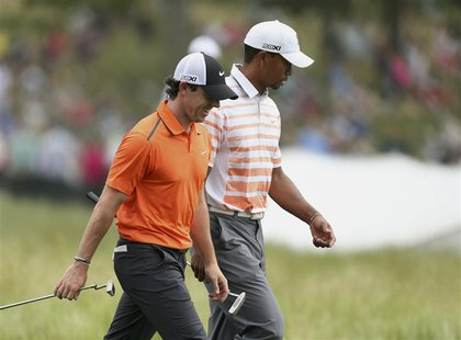 Northern Ireland's Rory McIlroy (L) and Tiger Woods of the U.S. walk together on the 10th fairway during the second round of the 2013 U.S. O